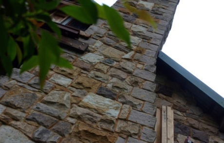 sandstone chimney and fireplace